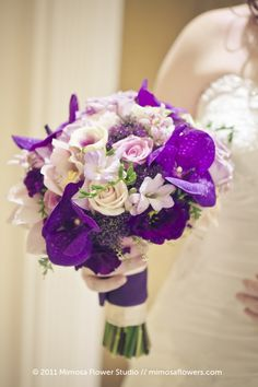 Purple and white and orchid bouquet