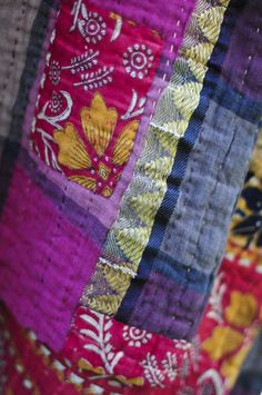 Kantha blankets. Proceeds go back to the women who made these in Calcutta to help them stay out of the red district.