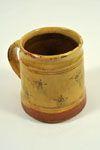 Mug White slip, sgraffitoed design & copper flashes Dimensions: H 11cm x W 10cm  Artist: Michael Cardew  Company: Winchcombe Pottery  Notes: Stamped 'MC' & 'WP'  www.burtonartgallery.co.uk