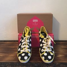 Kate spade shoes Kate Spade edition Keds... Black with white apples, yellow trim around shoes. Comes with two pairs of shoe laces, a white pair and a yellow pair. New in box, Not interested in Trading please don't ask Shoes Sneakers