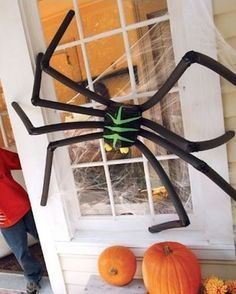 How to make a GIANT Spider: Start by getting a jug from a gallon of milk. Cut the top off You'll use black Duct Tape to cover the jug Then tape some black insulation tubing across the back, …