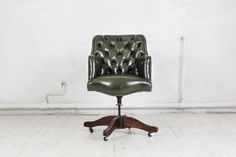 Dartmouth green Study Swivel Chair A beautiful Dartmouth green Study Chair. A perfect armchair for a study, office, library or in fact any room. Lovely smooth seat, deep buttoning on the back and side of the chair are finished off by lovely brass studding around the full front of the chair.