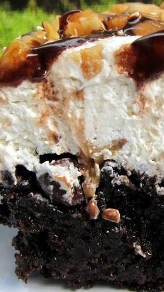 Snickers Poke Cake Recipe ~ Chocolate cake, caramel, whipped cream, peanuts and chocolate sauce... OMG!