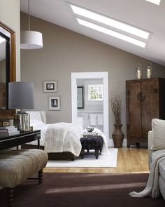Dark wood furniture with soft furnishings and colour create a classic, stylish look. A combi installation of white roof #windows ensure the #bedroom doesn't feel too oppressive. Via homedsgn.com.
