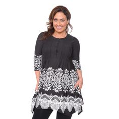 Featuring elaborate designs and a stylish fit, this tunic is a fashionable must-have. This top includes a shark bite hemline and two (2) pockets.