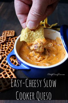One of the easiest dips to make EVER! Throw everything into the slow cooker then enjoy! Easy-Cheesy Slow Cooker Queso Recipe