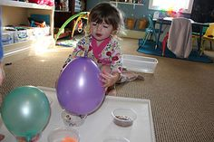Sound Balloons - fill balloons with variety of objects (one with bells, one with beans, one with marbles, etc.); let kids play... match balloons to container with correct item