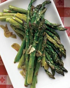 Garlicky Roasted Asparagus Recipe--  this has become my favorite way to cook most veggies, but I'd never tried it with asparagus.