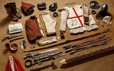 Earlier English longbowman equipment including gambeson, bascinet, buckler, falchion, dagger and longbow. According to a later household accounting book of 1480 AD, a typical English longbowman was protected by brigandine. He was also issued a pair of splints for arm defenses, a 'sallet', a 'standart', a 'jaket', a 'gusset', and a sheaf of arrows. (More on Realm of History)