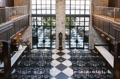Indoor Wedding Reception with Checkered Floor and Black Chairs at South Tampa Modern, Vintage Wedding Venue Oxford Exchange   Tampa Wedding Planner Southern Elegance Events