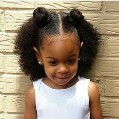 How adorable is she with her double top knot protective hairstyle