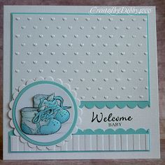 handmade card ... welcome baby ... medallion with adorable blue baby shoes ... embossing folder textures... like how th emedailllion is layered ... sweet caard!!