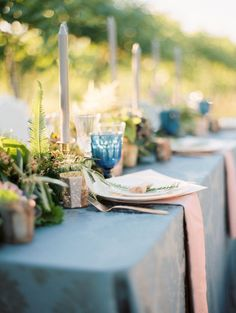 To incorporate elements of blue, without being too overpowering, select a few blue details for your wedding reception tables. Blue glassware is a great accent detail to include. | 12 Beautiful Blue Wedding Ideas and Details