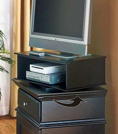 """This wooden TV and DVD Swivel Stand rotates 360 degrees so you can view your TV from any angle. Set it on a piece of furniture for the perfect viewing height. The shelf below (19-1/2""""W x 12-7/8""""D x 5-3/4""""H) holds your DVD player, cable box or gaming cons"""