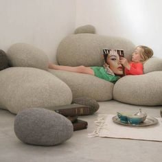 Oversized pebble cushions are comfy and cozy for a reading nook in a nursery or kids room.