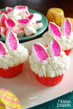 I would add a nose to the bunny.  Make these adorable Easter cupcakes that look like little bunny ears! They are so simple and use marshmallows as the ears. Get your kids involved too!