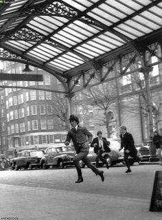 Mr. George Harrison running into Marylebone railroad Station in London during the filming of A Hard Day's Night (1964)