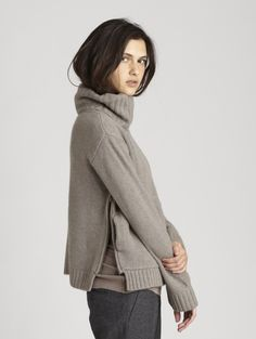Cashmere turtleneck sweater w/side zippers.