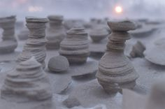 Strong Winds Carve Otherworldly Towers from Frozen Sand on the Shore of Lake Michigan  http://www.thisiscolossal.com/2015/02/ice-sand-scultpures-lake-michigan/