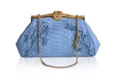 This blue python bag on a vintage frame was made personally as a wedding gift for a dear friend of Anthony's.
