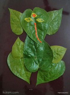 Rangoli Pookalam (Pookolam): Leaf ganesha by Rangoli Designs Flower, Colorful Rangoli Designs, Rangoli Ideas, Rangoli Designs Diwali, Flower Rangoli, Beautiful Rangoli Designs, Diya Designs, Rangoli Patterns, Kolam Designs