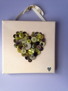 Handmade button mosaic heart, button heart, button art, cream and avocado green by MosaicTreasureBox on Etsy https://www.etsy.com/listing/180786333/handmade-button-mosaic-heart-button