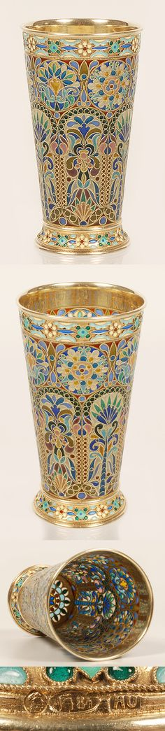 A Russian silver gilt and plique-a-jour enamel beaker by Ovchinnikov, Moscow, circa 1908-1917. Of tapering cylinsrical form on a flared foot, the body worked in arched panels of multi-color stylized foliate motifs beneath a band of circular roundels, the rim and foot with applied cloisonne floral bands.