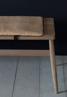 The Imo bench by Pinch Design Upholstered pad with leather fasteners optional. Dimensions: 1670w x 430d x 430h Finishes: white oiled oak seat and legs.