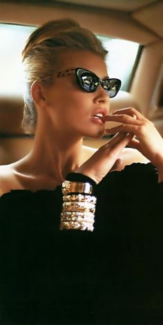 Cat eye sunglasses and a stack of bangles is all you need