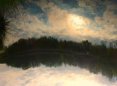 Picture of mirrored clouds in Dutch nature; inspired on Paul Gauguin
