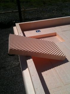 Most Isoquick foundations include two layers of EPS under the slab. The EPS panels are formed with an egg-carton pattern to help the layers lock together.