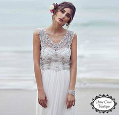 A white lace mexi wedding dress. Featuring a V neck. Custom made. Oh, and it's on sale!