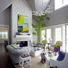 In the living room of a house in California wine country, designer Stephen Shubel painted the stone fireplace and Currey & Company's Rainforest chandelier a powdery white, and the walls and ceiling in a pale gray. Painted stone can look good, I guess. Home Living Room, Living Room Designs, Living Room Decor, Living Spaces, Living Area, White Stone Fireplaces, Brick Fireplace, White Fireplace, Fireplace Ideas