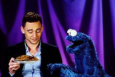 Want some cookies? - Tom Hiddleston gif.  Not sure who is cuter, Tom Hiddleston or Cookie Monster.