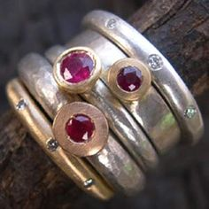stack of three ruby rings with two diamond eternity rings