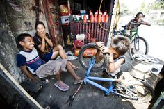 On the streets of Dili, the East Timorese capital, a group of young boys run a bicycle repair shop. Forty per cent of the population lives on less than $1 a day, so every extra penny is vital. Dili, East Timor, 2008. (Photo ©Progressio)