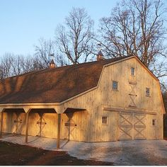 Farm history deeply rooted farms black siding gambrel for Gambrel barn plans with living quarters