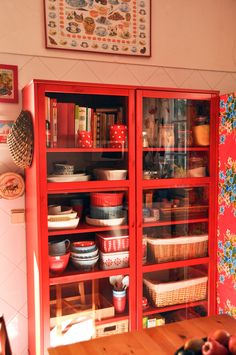 I want a huge glass door bookshelf in the kitchen to display my vintage pyrex collection!
