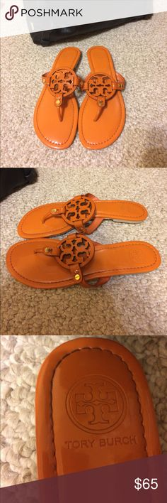 Tory Burch Miller Orange Sandals These sandals are orange with a leather strap. They have barely any signs of wear but they do buckle up just a bit in the middle. This does not affect the shoe when worn. I got these shoes from a friend... so I cannot guarantee authenticity! (Let me know if you can help me out here!) I'd be happy to take more photos if requested! Tory Burch Shoes Sandals