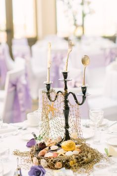 a fun Disney wedding centerpiece with a candelabra with cutlery, a fish net and . a fun Disney wedding centerpiece with a candelabra with cutlery, a fish net and shells and star fish. Disney Wedding Centerpieces, Wedding Themes, Wedding Colors, Wedding Decorations, Little Mermaid Centerpieces, Wedding Table, Diy Wedding, Dream Wedding, Diy Disney Wedding Ideas
