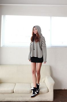 Sporty Casual Daily Wear Outfit : Black & white stripe hoodie, black mini skirt with black & white high top shoes.
