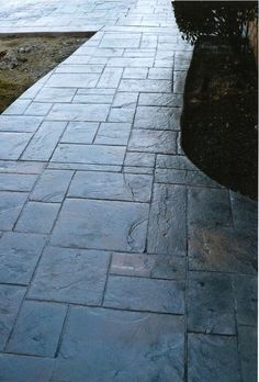 stamped concrete patio....looks like slate! My in-laws have a patio done like this and it is absolutely gorgeous!