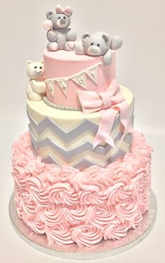 Layered Pink cake perfect for a girls baby shower. Topped with teddy bears