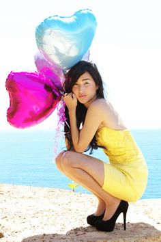 balloons, yellow dress, mint green nail polish and scenery.  :) what great imagery