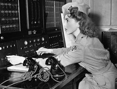 Movie actress Ida Lupino, is a lieutenant in the Women's Ambulance and Defense Corps, and is shown at a telephone switch board in Brentwood, CA, on January 3, 1942. In an emergency she can reach every ambulance post in the city.