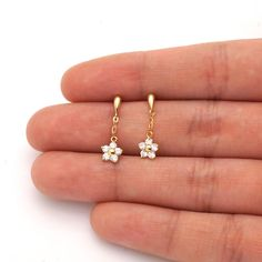 These cute dangle drop flower shaped stud earrings are sparkled with various birthstones like white zircon, ruby and pink tourmaline totaling six variations. Pearl Necklace Designs, Jewelry Design Earrings, Gold Earrings Designs, Ear Jewelry, Girls Jewelry, Cute Jewelry, Jewelry Accessories, Kids Earrings, Simple Earrings