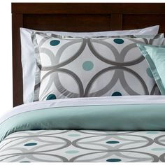 SEE THE COLOR CHOICES FOR THIS COMFORTER SET FOR: Dark Teal and Coppery Orange combo is pretty- perhaps use the deep teal for a parlor color accent? Maybe on the console by door and candles/pillows/recliner cover? Found it at AllModern - Simonides Reversible Comforter Set
