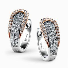 The modern design of these white and rose gold earrings is accentuated by ctw of glistening round cut white diamonds. Diamond Earing, Diamond Jewelry, Jewelry Rings, Silver Jewelry, Men's Jewellery, Designer Jewellery, Diamond Stud, Jewellery Designs, Silver Rings