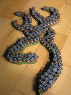 Recycled shotgun shell Browning wall art - i like this idea.