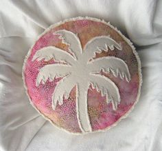 Palm tree pillow multi color batik in magenta, yellow gold, taupe, and natural denim round pillow